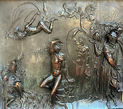Bronze relief sculpture on the streets of Florence, Italy.