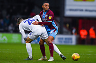 Funso Ojo of Scunthorpe United (6) evades the very close attention of Tom Bayliss of Coventry City (20) during the EFL Sky Bet League 1 match between Scunthorpe United and Coventry City at Glanford Park, Scunthorpe, England on 5 January 2019.