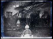 toddler in garden setting France 1921