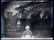 toddler in garden setting France 1921