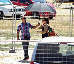 Kate Beckinsale seen on set of The Widow television series. She was filming in blistering heat & needed both a hand held fan & someone to hold a sun umbrella for her.