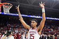 FAYETTEVILLE, AR - MARCH 4:  Mason Jones #15 of the Arkansas Razorbacks gets the crowd cheering during a game against the LSU Tigers at Bud Walton Arena on March 4, 2020 in Fayetteville, Arkansas.  The Razorbacks defeated the Tigers 99-90.  (Photo by Wesley Hitt/Getty Images) *** Local Caption *** Mason Jones