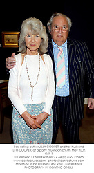 Best selling author JILLY COOPER and her husband LEO COOPER, at a party in London on 7th May 2002.OZP 1