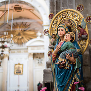 A statue of Mary and Child in front of the main altar of Iglesia de la Santisima Trinidad in Mexico City, Mexico. Iglesia de la Santisima Trinidad translates as Church of the Holy Trinity.
