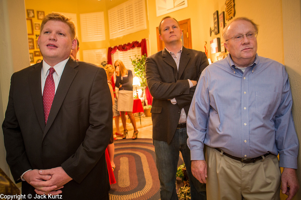 """03 AUGUST 2012 - GILBERT, AZ:   WIL CARDON (left) stands among Republican voters during a """"meet & greet"""" in a private home in Gilbert, AZ, Friday. Cardon, a wealthy businessman, is running in the Republican primary for the US Senate seat being vacated by Sen. Jon Kyl. He is running against long serving Congressman Jeff Flake, who currently represents Arizona's 6th Congressional District, a conservative, largely Mormon, district in the suburbs of Phoenix. Both Cardon and Flake are active Mormons and both men are running as """"Tea Party"""" inspired conservatives. Whoever wins the August 28 primary will face Dr. Richard Carmona in November's general election.  PHOTO BY JACK KURTZ"""