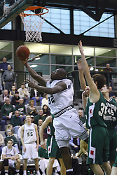 17 December 2011: Victor Davis scoops up a shot during an NCAA mens division 3 basketball game between the Washington University Bears and the Illinois Wesleyan Titans in Shirk Center, Bloomington IL