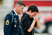 A grieving Stephanie Kidder, wife of Army Spc. Christopher Fishbeck, is escorted back to the side of the tarmac after she went out to meet the casket of her husband during a repatriation ceremony at Joint Forces Training Base Los Alamitos, CA. Fishbeck, along with four other soldiers from his unit, was killed on June 6, 2011 in Baghdad when enemy forces attacked his unit.