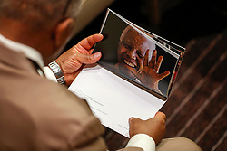(170718) -- UNITED NATIONS, July 18, 2017 (Xinhua) -- An attendee looks at a photo of Nelson Mandela during a ceremony marking Nelson Mandela International Day at the UN headquarters in New York, on July 18, 2017. Marking Nelson Mandela International Day, UN Secretary-General Antonio Guterres on Tuesday called for actions across the world in promoting peace, sustainable development and lives of dignity for all. (Xinhua/Li Muzi) (Photo by Xinhua/Sipa USA)