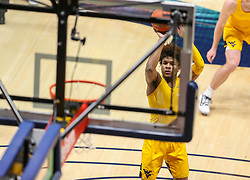 Jan 25, 2021; Morgantown, West Virginia, USA; West Virginia Mountaineers guard Miles McBride (4) warms up prior to their game against the Texas Tech Red Raiders at WVU Coliseum. Mandatory Credit: Ben Queen-USA TODAY Sports