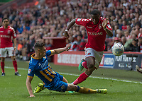 Football - 2017 / 2018 Sky Bet EFL League One - Play-Off Semi-Final, First Leg: Charlton Athletic vs. Shrewsbury Town<br /> <br /> James Bolton (Shrewsbury Town FC) slides in to take out the run of Stephy Mavididi (Charlton Athletic FC) at The Valley<br /> <br /> COLORSPORT/DANIEL BEARHAM