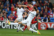 Sam Vokes of Wales is stopped by a tackle by Solomon Kverkvelia of Georgia (5).Wales v Georgia , FIFA World Cup qualifier, European group D match at the Cardiff city Stadium in Cardiff on Sunday 9th October 2016. pic by Andrew Orchard, Andrew Orchard sports photography