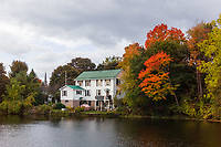 https://Duncan.co/house-on-riverbank-and-fall-color