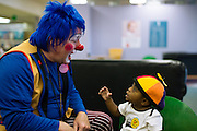 """BIRMINGHAM, AL – OCTOBER 31, 2011: Mike Coppage, or """"Beanie the Clown,"""" as he's known to children, is one of 30 clowns who make regular appearances at Children's of Alabama hospital, bringing much-needed moments of laughter to children and their families as they confront frightening illnesses and healthcare crises. Coppage enrolled in clown school in 2009 after seeing the Children's clowns in a local news feature, and to date, Magic City Clown School has trained more than 250 clowns in costuming, skits, balloon twisting, puppetry and all other areas of clowning. Many of the graduates volunteer at Children's, and a number of them also make appearances at other hospitals, nursing facilities, and charity events. Coppage, who has served as Birmingham's police chief, director of public safety for Alabama, and now director of public safety and emergency management for Samford University, knows his two identities seem like polar opposites, """"but the ones who know me well say I've always been a clown,"""" he said."""