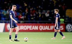 Scotland's Oliver McBurnie appears dejected after Kazakhstan's Yuriy Pertsukh (not in picture) scores his side's first goal of the game during the UEFA Euro 2020 Qualifying, Group I match at the Astana Arena.