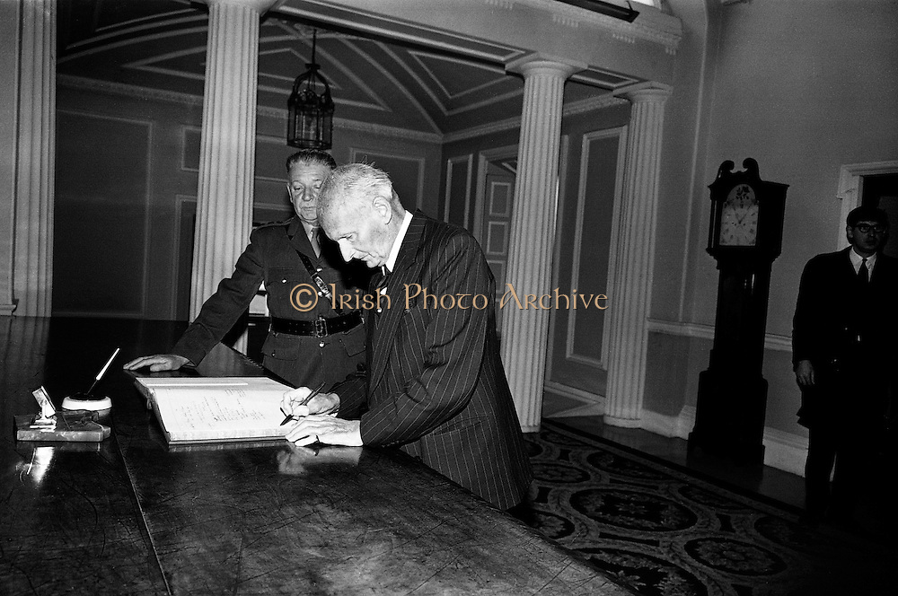 Field Marshal Viscount Bernard Montgomery chats with President de Valera at Aras an Uachtarain,. During WW II he was Commander of the 8th Army, before being given responsibility for planning the D-Day landings in Normandy. In the Irish War of Independence, Montgomery was in charge of the British 17th Infantry Brigade, stationed in Co Cork. Pictured signing the visitors book..22.09.1967