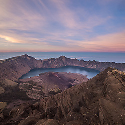 Mount Rinjani (Gunung Rinjani) - an active volcano in Indonesia on the island of Lombok. It rises to 3,726 metres above sea level, making it the second highest volcano in Indonesia, and probably the toughest one to climb. The caldera is filled partially by the crater lake known as Segara Anak or Anak Laut (Child of the Sea), due to the color of its water, as blue as the sea (laut). There are several hot springs inside and nearby the Caldera. The Sasak tribe and Hindu folks assume the lake and the mount are sacred, so they lead a pilgrimage to the lake annually to worship the spirits.