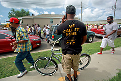 29 August 2014. Lower 9th Ward, New Orleans, Louisiana. <br /> Survivors of the storm. A second line parade with residents, activists and survivors makes its way through the Lower 9th Ward in memory of those who perished in the storm 9 years ago. <br /> Photo; Charlie Varley/varleypix.com