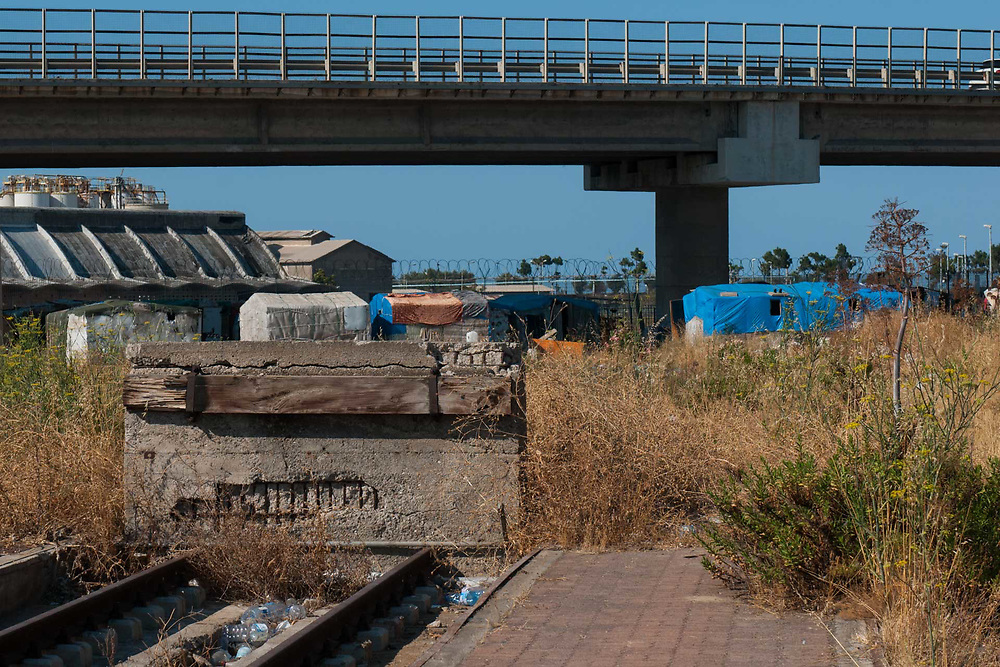 A camp of illegal migrants is seen on August 03, 2017 in Crotone, Italy. The city of Crotone hosts one of the biggest european centre for migrants, but some of them live in clandestinity, even for two years, in an area near the city railway station, because they are afraid to be rejected and to be sent to their nations again. ©Simone Padovani