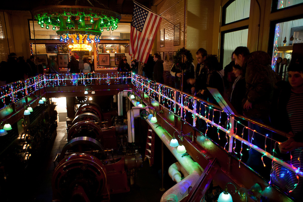 The public is allowed to tour the power plant both before and after the whistles are blown. The gallery is festooned with holiday lights.