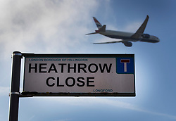 "© Licensed to London News Pictures. 27/10/2016. London, UK. A British Airways airliner takes off from Heathrow - in sight of a sign for Heathrow Close - a residential street in the village of Longford. The government has announced that a third runway will be built at the United Kingdom's busiest airport. The Cabinet are divided - with Foreign Secretary Boris Johnson saying that the project is ""undeliverable"". Conservative MP for Richmond Zac Goldsmith has resigned. Photo credit: Peter Macdiarmid/LNP"