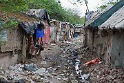 Street scenes of Tehkhand Slum, Delhi, India.  Indian slums are characterized with substandard housing, squalor and lacking in security.  They are home to increasing numbers of people and families who are usually very poor or socially disadvantaged. Most slums lack clean water, sanitation and other basic services, and as such they pose a serious threat to public health as infectious diseases are able to spread easily.