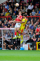 Bristol City's Joe Bryan battles for the high ball with Milton Keynes Dons' George Baldock  - Photo mandatory by-line: Joe Meredith/JMP - Mobile: 07966 386802 - 27/09/2014 - SPORT - Football - Bristol - Ashton Gate - Bristol City v MK Dons - Sky Bet League One