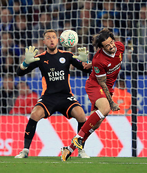 Liverpool's Danny Ings heads clear during the Carabao Cup, third round match at the King Power Stadium, Leicester.