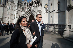 © Licensed to London News Pictures. 30/03/2012. London, UK.  Nilam Mindochia (left) and Vinod Mindochia (right), the parents of Anni Dewani,  leaving The High Court on March 30, 2012 where a judge temporarily halted British businessman Shrien Dewani's extradition to South Africa on mental health grounds. Shrien Dewani, is accused of arranging the contract killing of wife Anni in Cape Town in November 2010. Photo credit : Ben Cawthra/LNP
