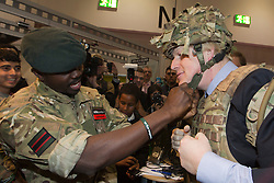 "© Licensed to London News Pictures. 22/11/2013. London, England. Pictured: Boris Johnson dresses up as a soldier in a bullet-proof vest and a helmet. Boris Johnson, Mayor of London, today visited the UK's biggest jobs and careers fair ""Skills London"" at the Excel Exhibition Centre and went on a walkabout where he visited stands and performed some of the jobs on show. Photo credit: Bettina Strenske/LNP"