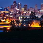 Kansas City Missouri skyline at dusk from Penn Valley Park.