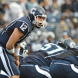 Oct 31, 2009; East Hartford, CT, USA; Connecticut quarterback Cody Endres (12) barks out instructions to his linemen during first half Big East NCAA football action between Rutgers and Connecticut at Rentschler Field.