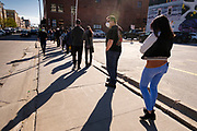 31 OCTOBER 2020 - DES MOINES, IOWA: People lined up to vote near the Polk County Auditor's Office in Des Moines. This is the last weekend of early voting before the 2020 US presidential election. The line to vote at the Polk County Auditor's Office was 5 blocks long Saturday morning. An elections official said that by November 3, which is Election Day, about 45 percent of the registered voters in Polk County will have already voted.     PHOTO BY JACK KURTZ