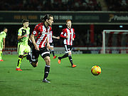 Brentford striker Lasse Vibe setting up an attack during the Sky Bet Championship match between Brentford and Huddersfield Town at Griffin Park, London, England on 19 December 2015. Photo by Matthew Redman.