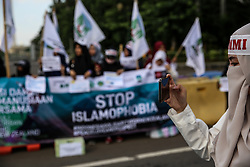 March 22, 2019 - Jakarta, Indonesia - Indonesian Muslim take part in an anti-racist and anti-fascist rally against Islamophobia in Jakarta, Indonesia on 22 March, 2019. At least 50 people were killed by a gunman, believed to be Brenton Harrison Tarrant, and 20 more injured and in critical condition during the terrorist attacks against two mosques in New Zealand during Friday prayers on 15 March. (Credit Image: © Andrew Gal/NurPhoto via ZUMA Press)
