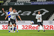 Cardiff City forward Kieffer Moore (10) heads the ball towards goal during the EFL Sky Bet Championship match between Derby County and Cardiff City at the Pride Park, Derby, England on 28 October 2020.