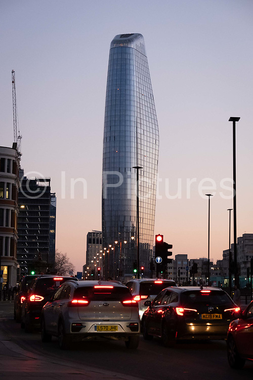 Seen from the City of London, One Blackfriars one of the capitals newest skyscrapers rises above evening rush-hour traffic, on 27th February 2021, in London, England. Located on Bankside, the south bank of the river Thames, the development is a 52-storey 170m tower whose uses include residential flats, a hotel and retail.