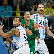 Fenerbahce Ulker's Oguz Savas (R) and Panathinaikos's Mike Batiste (C) during their Euroleague Top 16 week 3 game 3 basketball match Fenerbahce Ulker between Panathinaikos at Fenerbahce Ulker Sports Arena in Istanbul Turkey on Thursday 02 February 2012. Photo by TURKPIX