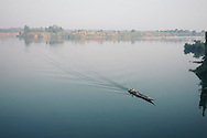 A tiny barge crosses the Mekong River in Stung Treng province, Cambodia, Southeast Asia