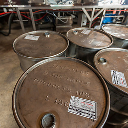 Stainless steel barrels are used to store and transport maple syrup at the LaRiviere family syrup operation in Big Six Township, Maine.