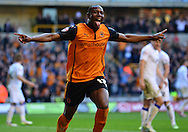 Benik Afobe celebrates scoring third goal during the Sky Bet Championship match between Wolverhampton Wanderers and Leeds United at Molineux, Wolverhampton, England on 6 April 2015. Photo by Alan Franklin.