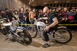 "Jeff Leighton on his 1950 Triumph 650 Pre-Unit ""ORCRIST"" for the Grand Entry into the Mooneyes Yokohama Hot Rod & Custom Show. Yokohama, Japan. December 6, 2015.  Photography ©2015 Michael Lichter."