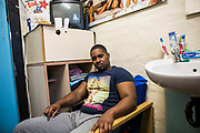 A prisoner sitting in hs cell at HMP/YOI Portland, Dorset. A resettlement prison with a capacity for 530 prisoners. Portland, Dorset, United Kingdom.