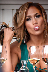 April 25, 2019 - New York, New York, U.S. - Jennifer Lopez pops a gum bubble during a scene on location filming 'Hustlers' in New York City. (Credit Image: © Kristin Callahan/Ace Pictures via ZUMA Press)