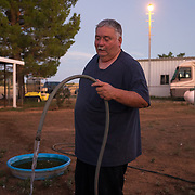 Richard Wilson waters his animals, August 13, 2019, at his home in Cochise, Arizona. Wilson's well went dry and he is now hauling water to his property.<br /> <br /> In a roundup of the year's best environmental journalism, The New York Times singled out the unprecedented look at aquifer degradation in Arizona by Ian James, Rob O'Dell and Mark Henle. The Republic team analyzed water-level data for more than 33,000 wells throughout Arizona, including some records going back more than 100 years, and nearly 250,000 well-drilling records. The findings are alarming for anyone with an eye on Arizona's future. Groundwater is plummeting. Water levels in a quarter of the wells have dropped 100 feet or more since they were drilled. Some of the biggest users are probably large industrial farms that have moved into far-flung desert land in recent years. These big farms drill wells as deep as half a mile into the earth. Nearby, homeowners discover their own shallower wells are running dry. When that happens, there's nobody –– no regulator, no financier –– to help them. This project was the result of monumental reporting by Ian and Rob, who have been analyzing hundreds of thousands of data points and traveling to distant farms for months. It comes to life through the visuals of Mark, who found sources and stories of his own as he turned his lenses on the groundwater problem, along with our drone team. They managed to capture aerial imagery of every big industrial farm profiled -- even the ones that wouldn't talk.