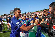 Marcelo Montoya and Jazz Tevaga with fans after beating the Dragons. St George Dragons v Vodafone Warriors. NRL Rugby League, Netstrata Jubilee Stadium, Sydney, NSW, Australia, Sunday 18th April 2021 Copyright Photo: David Neilson / www.photosport.nz