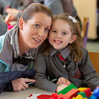 Ciara O'Connor Malone settling into school on her first day at Crusheen Natonal school with her mother Sandra