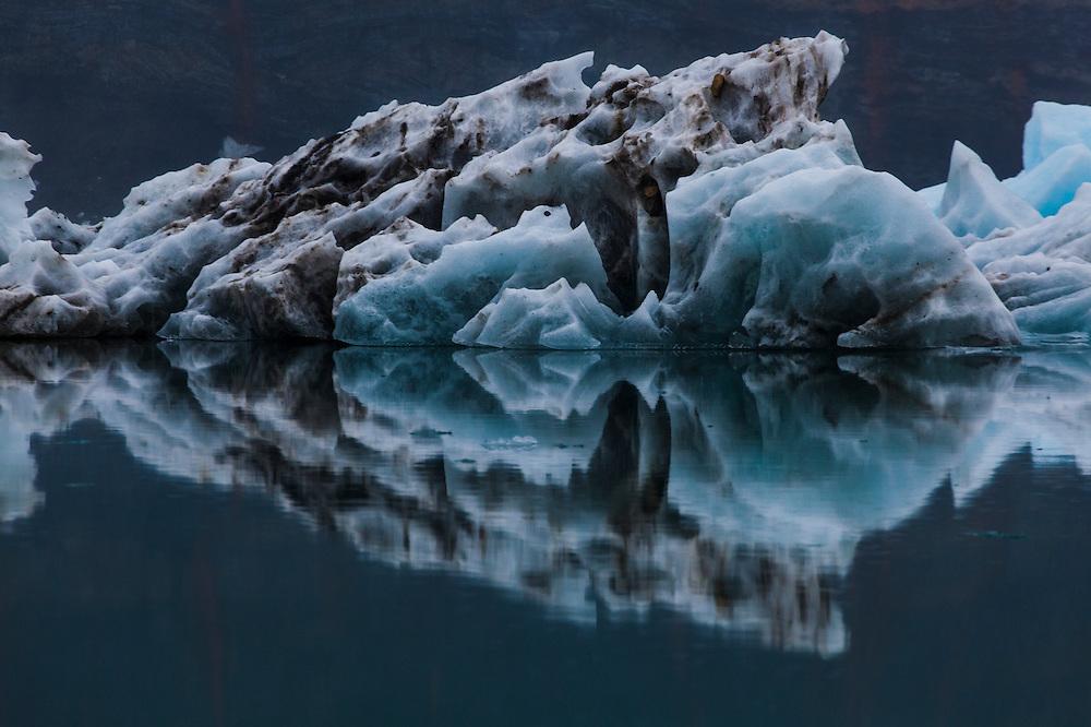 Symmetric reflection of a calved iceberg floating in Hornsund, Svalbard.