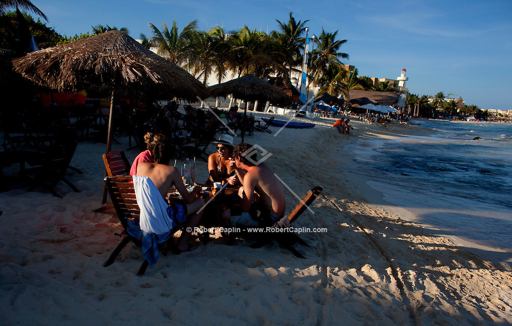 Vacationers on the white sand beach in Playa Del Carmen, Mexico. (Photo By Robert Caplin)