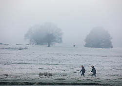 © Licensed to London News Pictures. 27/11/2020. London, UK. Walkers enjoy an early morning stroll through the fog in Richmond Park. Walkers, cyclists drivers and Black Friday shoppers were hit with dense fog and a heavy frost this morning as they did the daily commute through Richmond Park, South West London. Yesterday Health Secretary Matt Hancock set out his plans for the end of lockdown on the 2 of December and introduced a new Covid Tier 2 restriction system for London with shops, pubs and restaurants to open up again for the Christmas period. Photo credit: Alex Lentati/LNP