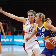 Galatasaray's Saziye IVEGIN (L) and Lotos Gdynia's Adrijana KNEZEVIC (R) during their woman Euroleague group A matchday 5 Galatasaray between Lotos Gdynia at the Abdi Ipekci Arena in Istanbul at Turkey on Wednesday, November 09 2011. Photo by TURKPIX